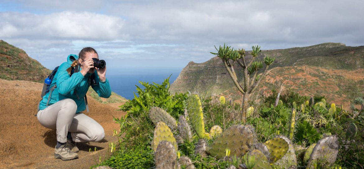 Girl photographs cactus in Anaga Mountains in Tenerife